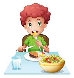 A boy eating vector image