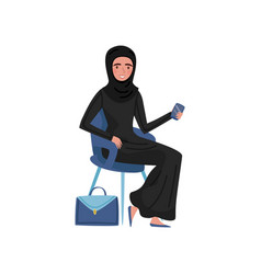 Muslim business woman sitting on chair and holding vector