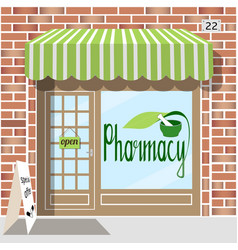 Pharmacy facade of red bricks vector