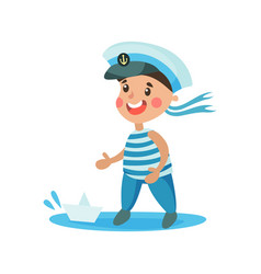cute little boy in sailors costume playing with vector image