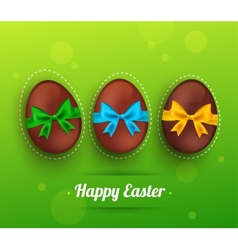 easter chocolate egg with ribbon on green vector image