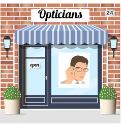 Opticians shop building with red bricks facade vector