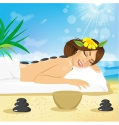 woman getting hot stones treatment vector image vector image