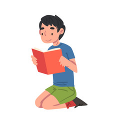 boy reading book sitting on floor on his knees vector image