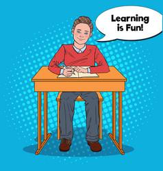 pop art happy schoolboy doing homework vector image vector image