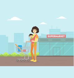 mother with toddler bain sling pushing shopping vector image