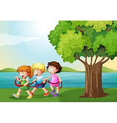 Three kids playing with the rope near the river vector image