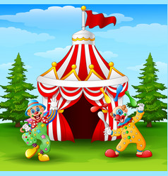 Cartoon happy clown on the circus tent background vector