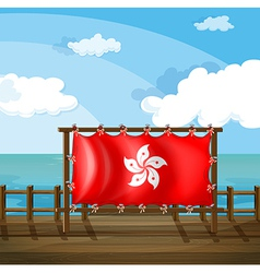 A wooden frame at the bridge with the flag of Hong vector