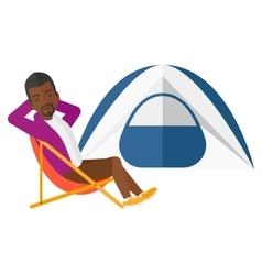 Man sitting in folding chair vector