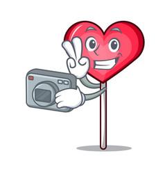 Photographer heart lollipop mascot cartoon vector