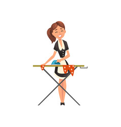 Smiling maid housemaid ironing clothes on an vector
