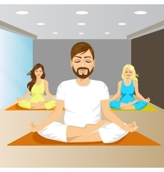 Young people sitting in yoga pose on mat in gym vector