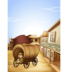 A little girl sitting in the wooden carriage vector
