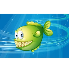 A green fish under the sea vector image