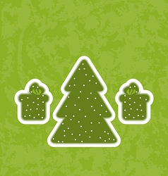 Green paper cut-out christmas tree fnd gifts vector image