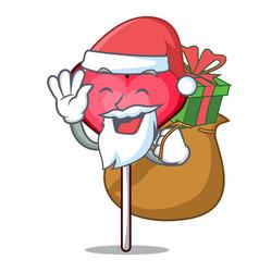 Santa with gift heart lollipop mascot cartoon vector
