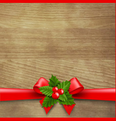 wooden background with red ribbon and holly berry vector image