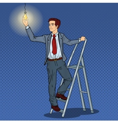 Pop Art Businessman with Ladder and Lightbulb vector image
