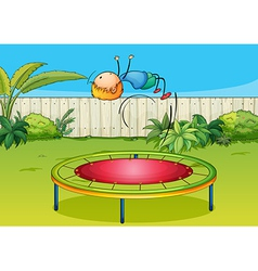 A boy jumping on a trampoline vector image vector image