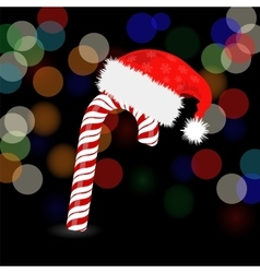 Candy Cane and Hat of Santa Claus vector image