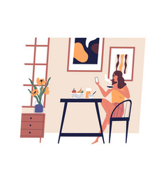 Cute girl sitting at table using smartphone vector