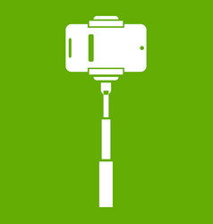 mobile phone on a selfie stick icon green vector image