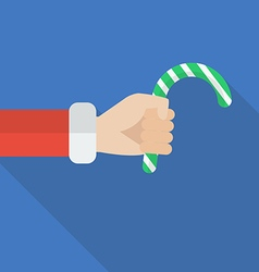 Santa hand holding christmas candy cane vector