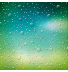 water drops on blurred nature vector image