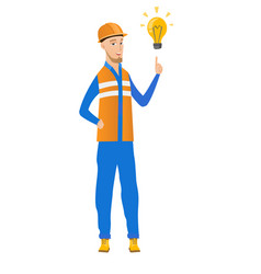 Young caucasian builder pointing at lightbulb vector