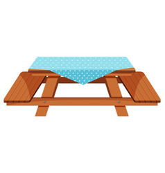 Wooden picnic table with blue tablecloth vector