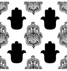 Ethnic pattern with hamsa vector