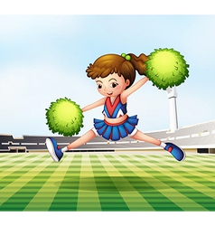 A cheerdancer with green pompoms at the soccer vector