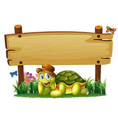 A smiling turtle below the empty wooden board vector