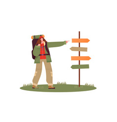 Woman pointing at guidepost with camping backpack vector