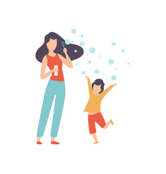 mother blowing bubbles with her little son happy vector image