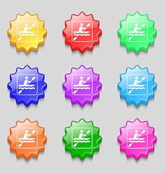 canoeing icon sign symbol on nine wavy colourful vector image