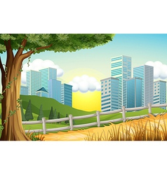 Hills with tall buildings nearby vector