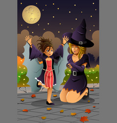 Mother daughter wearing halloween costumes vector