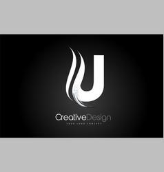 U letter design brush paint stroke on black vector