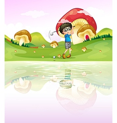 A boy playing golf at the riverbank vector