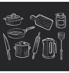 Hand drawn set of kitchen utensils on a chalkboard vector image