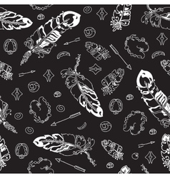 Seamless pattern with feathers and beads on black vector image