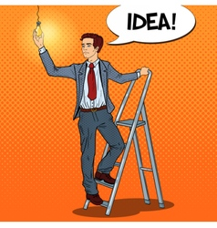 Pop art businessman with ladder and lightbulb vector