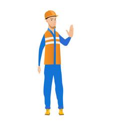 Young caucasian builder showing stop hand gesture vector