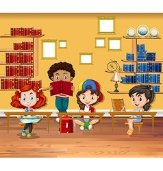 Children reading books in the classroom vector image vector image