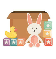 Stuffed bunny and cubes with ducky square frame vector