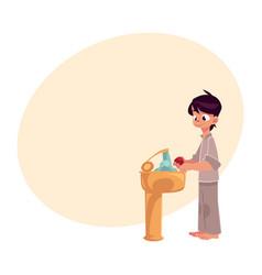 boy in pajamas washing hands with soap under vector image vector image