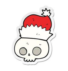 Sticker of a cartoon skull wearing christmas hat vector