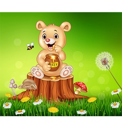 Cute little bear holding honey on tree stump vector